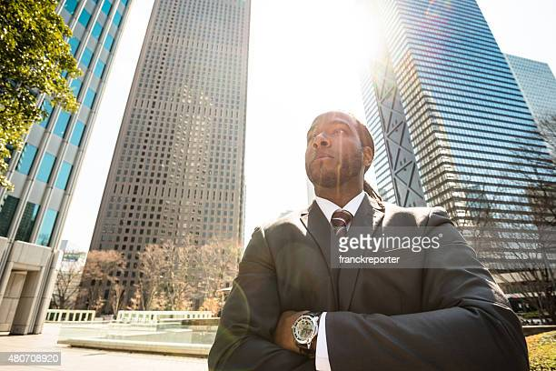 Business man standing on the city of Tokyo