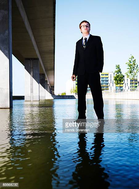 Business man standing on the water