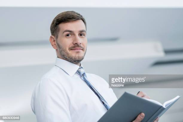 business man taking notes - workbook stock pictures, royalty-free photos & images