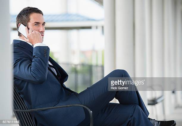 Business man talking on phone while sitting
