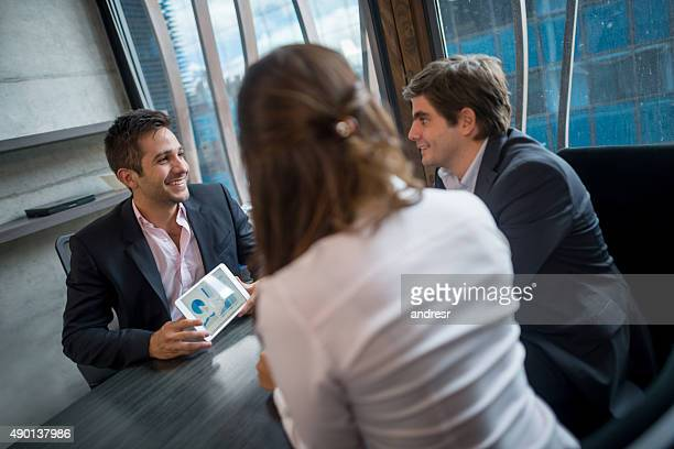 Business man talking to customers at the office