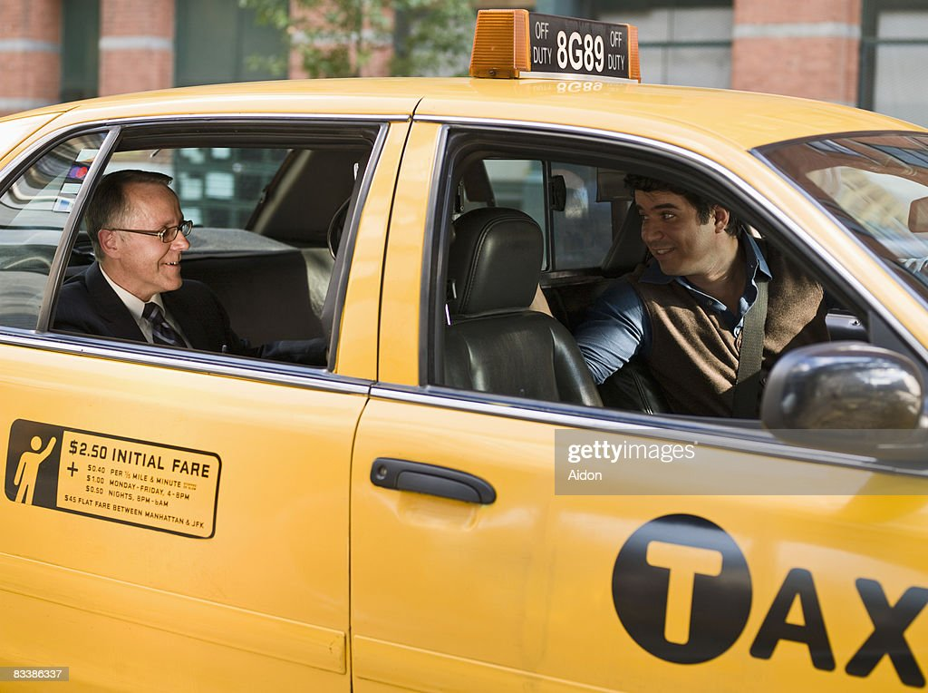 Business man talking with taxi driver : Stock Photo