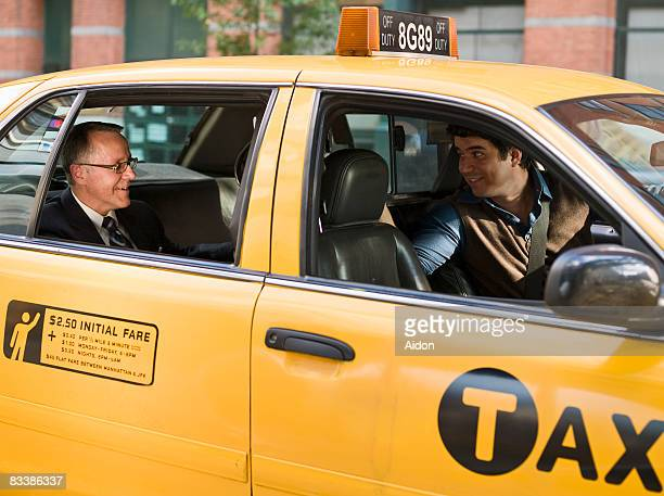 business man talking with taxi driver - taxi driver stock photos and pictures