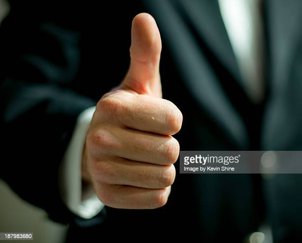 Business man thumb up