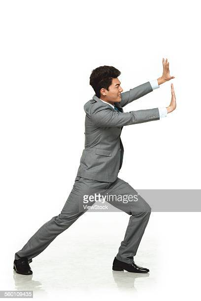A business man to do negative push posture