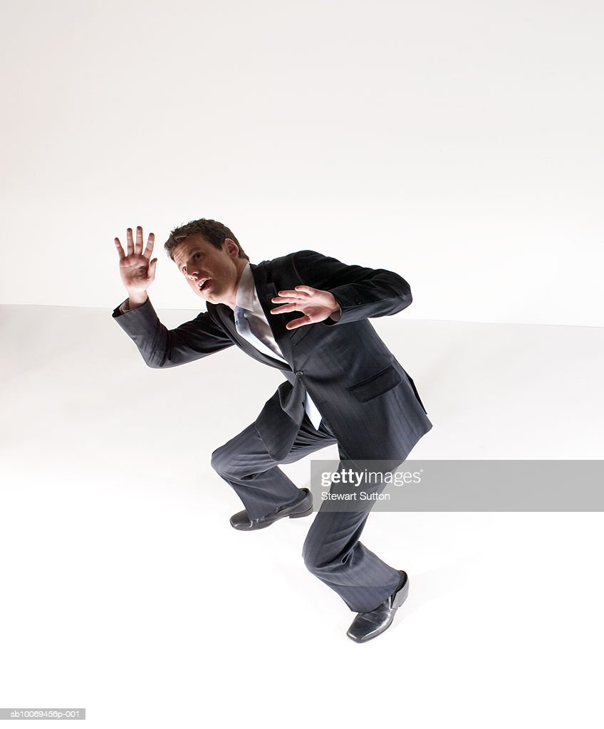 Business man trapped in fear, studio shot : Stock Photo