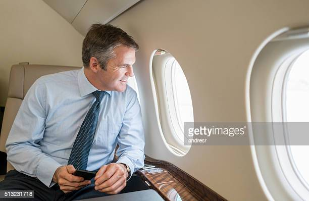 Business man traveling by plane