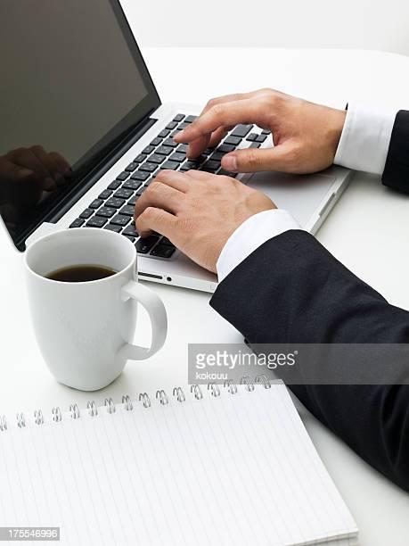 Business man types a keyboard