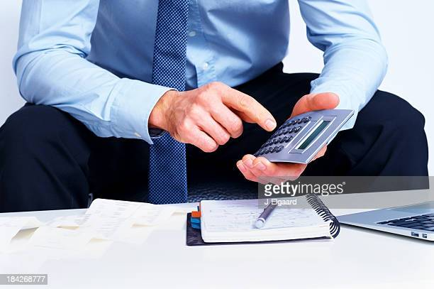 Business man use calculator on white background