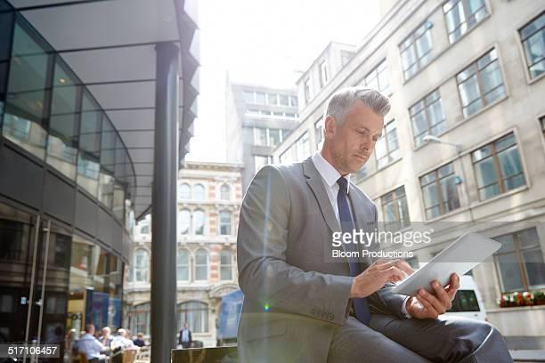 Business man using a digital tablet