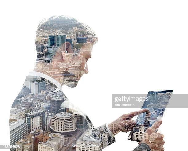 Business man using a tablet, and city view
