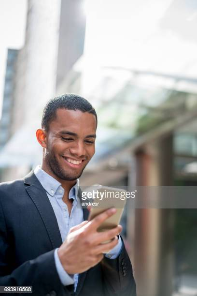 Business man using app on his mobile phone