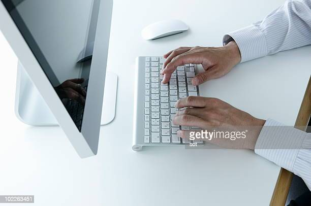 Business man using computer in office,close up