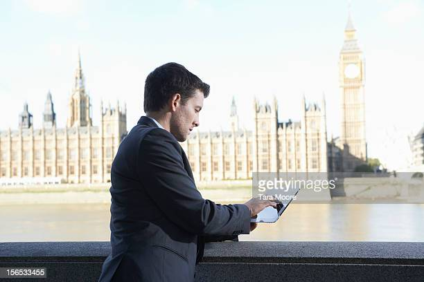 business man using digital tablet near westminster - river thames stock pictures, royalty-free photos & images