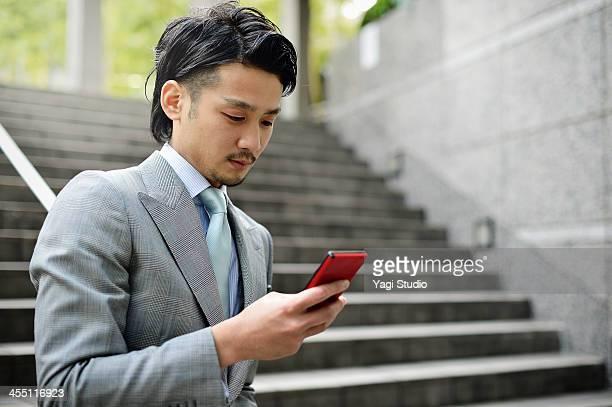 Business man using smartphone in buildings