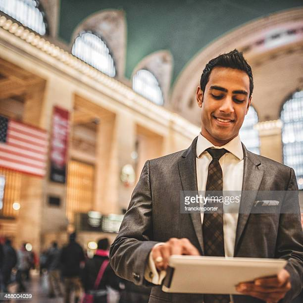 business man using tablet at central station