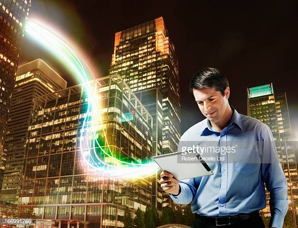 Business man using tablet with city scape behind