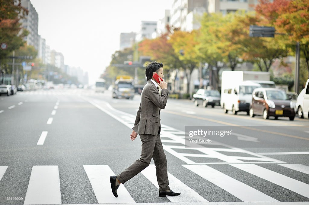 Business man using the smartphone in the city : Stock Photo