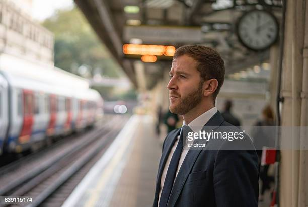 Business man waiting for the train in London