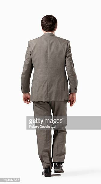 Business man walking away from camera