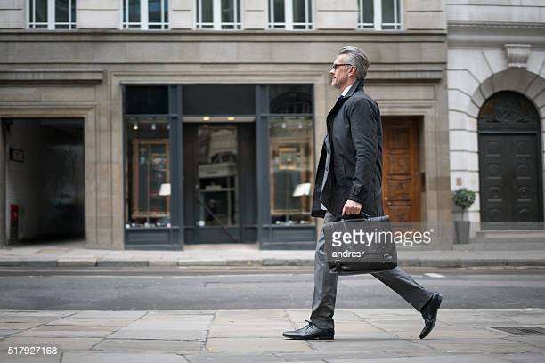Business man walking down the street
