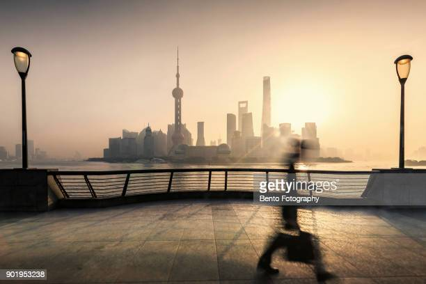 Business man walking in Shanghai