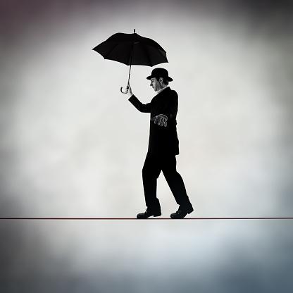 Business man walking on tightrope - gettyimageskorea