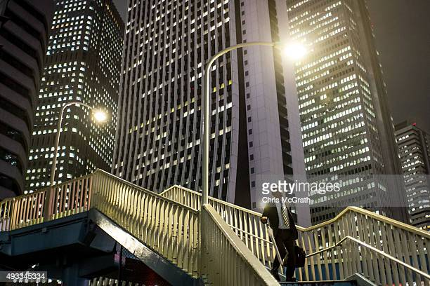Business man walks home from work on October 16, 2015 in Tokyo, Japan.