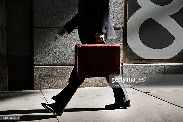 A business man walks outside of the New York Stock Exchange on October 7 2016 in New York City US stocks slipped Friday following a...