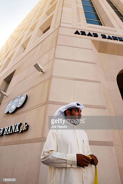 A business man walks past the Arab Bank November 252002 in Manama Bahrain With war in Iraq on the horizon the Middle East is preparing for some sort...