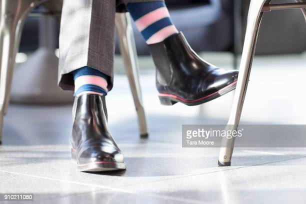 business man wearing colourful socks - leather boot stock pictures, royalty-free photos & images