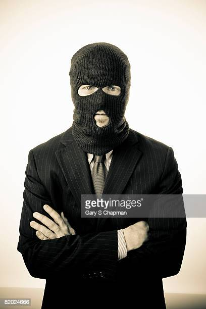 business man wearing ski mask - balaclava stock pictures, royalty-free photos & images