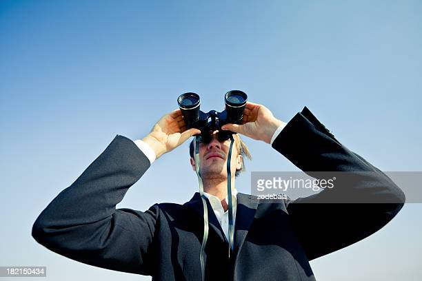 Business Man with Binoculars Searching New Opportunities