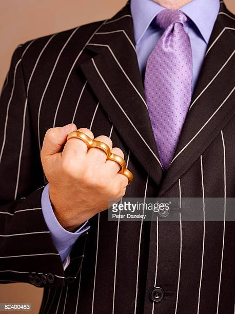 Business man with brass knuckle-duster