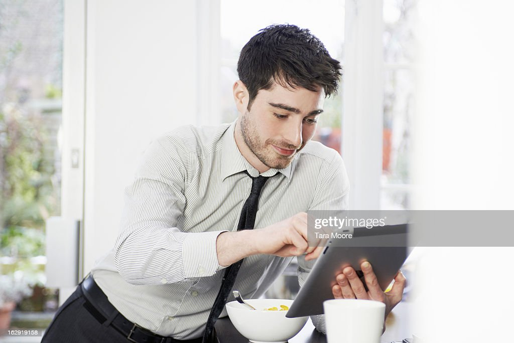 business man with breakfast and digital tablet : Stock Photo