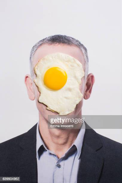 Business man with egg on his face