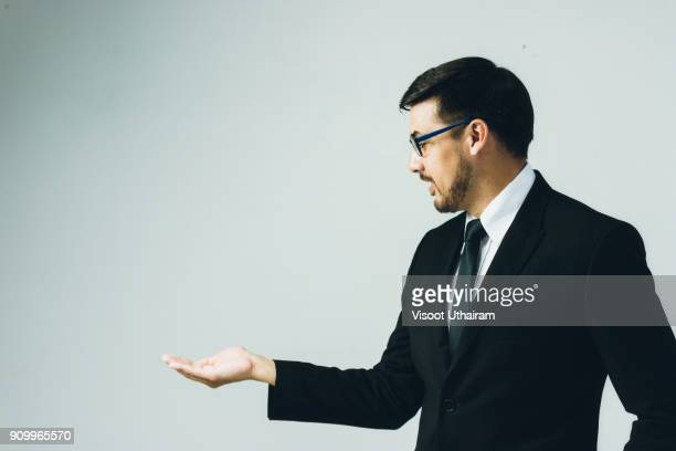 business man with empty hand - gesturing stock pictures, royalty-free photos & images