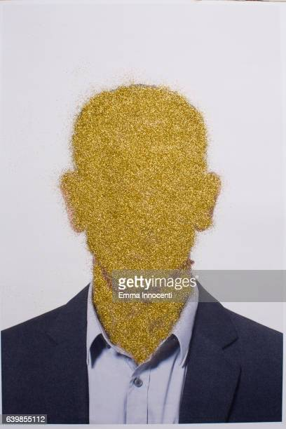 Business man with gold face and neck