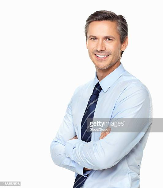 Business man with hands folded against white background