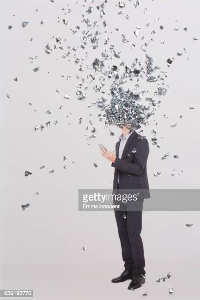 Business man with head covered by metal shavings