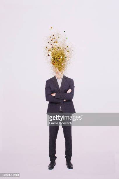 Business man with head exploding gold dust