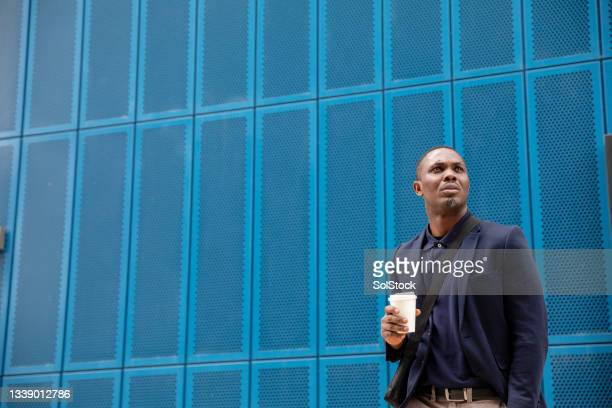 business man with his morning coffee in the city - green blazer stock pictures, royalty-free photos & images