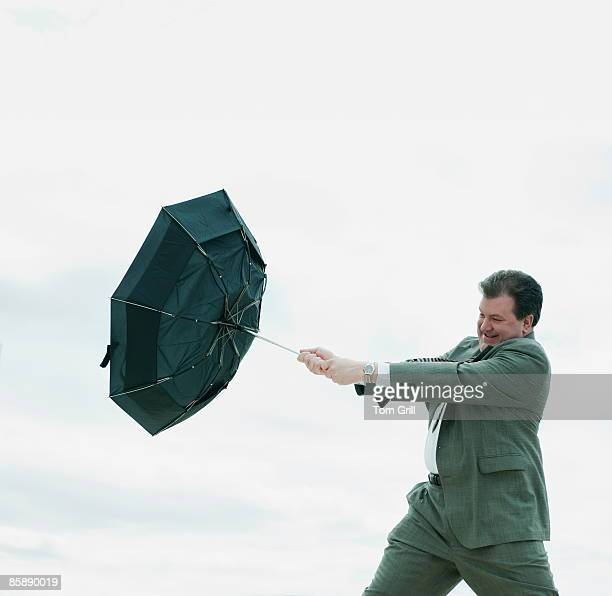 business man with inside out umbrella - inside out stock pictures, royalty-free photos & images