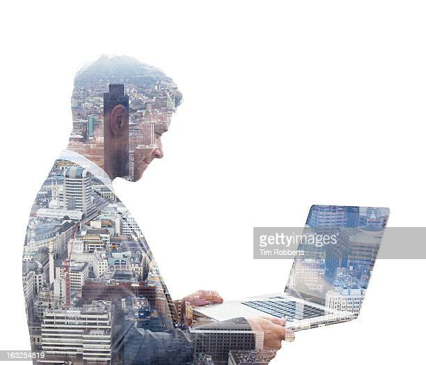 Business man with laptop, and city view