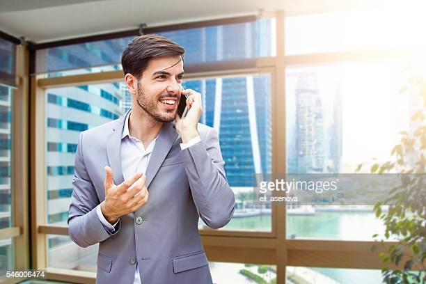 Business man with smart phone in Jumeirah Lake Towers Dubai