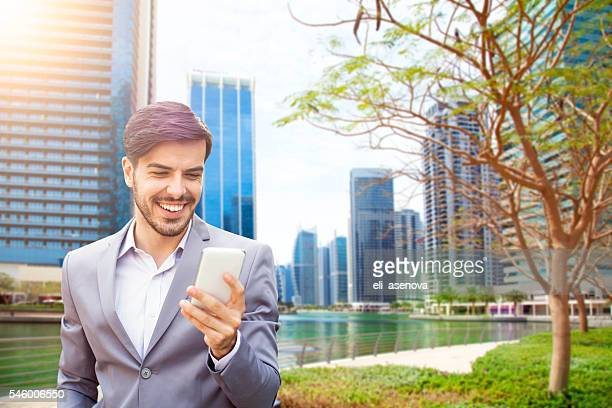 Business man with smart phone in Jumeirah Lake Towers Dubai