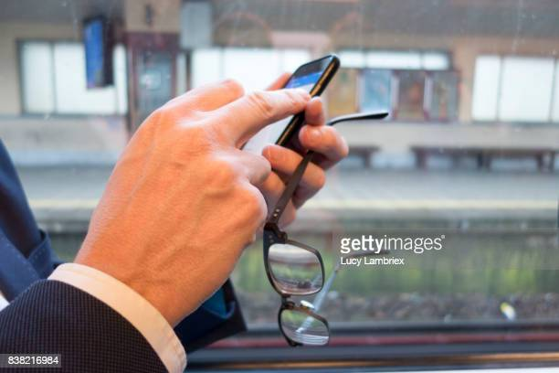 Business man with smartphone on the train