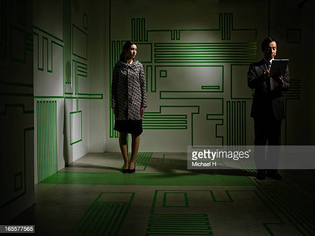 Business man with tablet PC and woman