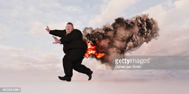 Business man with trousers on fire