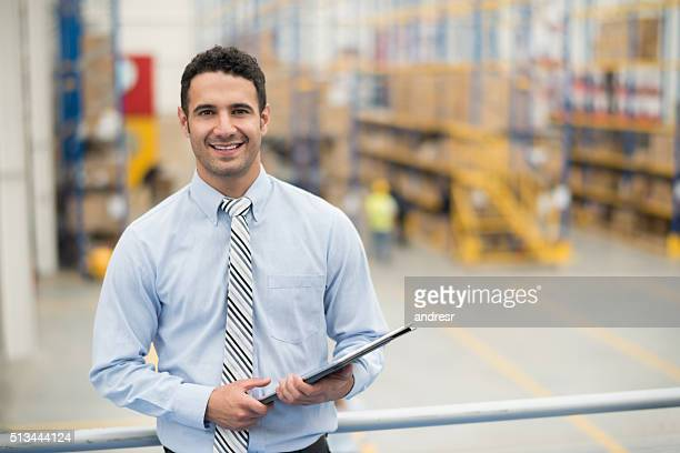 Business man working at a distribution warehouse